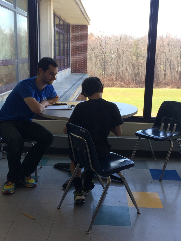 One-on-one student survey data collection in action.