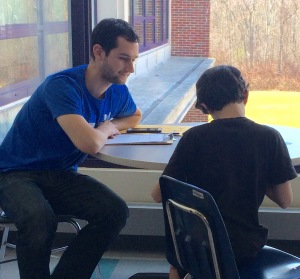 Research member interviewing student during the 2015 pilot program.